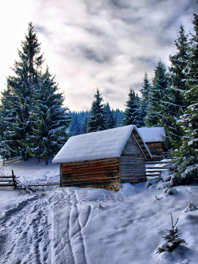 Winter Wooden Hut royalty free stock images