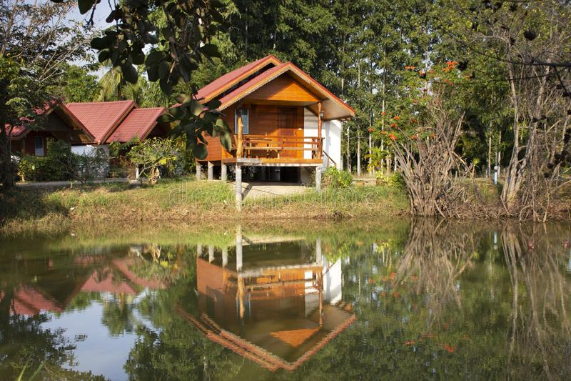 Wooden hut in garden of resort and homestay for thai people and foreigner travelers rent and rest in Chaiyaphum, Thailand. Wooden hut in garden of resort and stock images