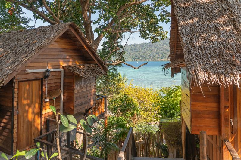 Wooden hut resort on hill with scenic sea stock images