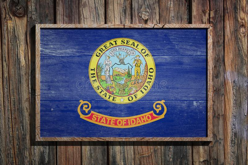 Wooden Idaho flag. 3d rendering of a Idaho State USA flag on a wooden frame and a wood wall vector illustration