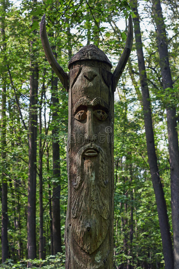 Wooden idol . Wooden idol worshiped by pagans stock image