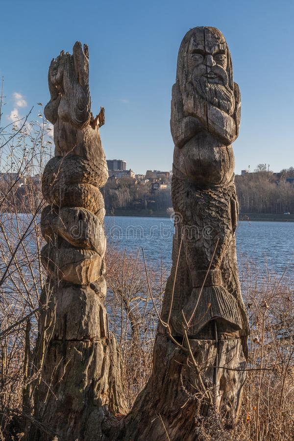 Wooden idols of the Slavic gods. Water in the background. Russia. Wooden idols of the Slavic gods. Water in the background royalty free stock photography