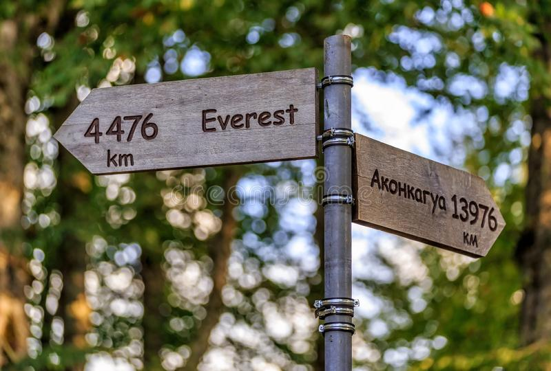 Wooden information arrows of tourist navigation pointing directions and distance to Everest and Aconcagua mountain peaks in. Sochi, Russia - circa September royalty free stock photos