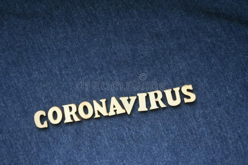 Wooden inscription coronavirus on dark background. World pandemic concept. royalty free stock image