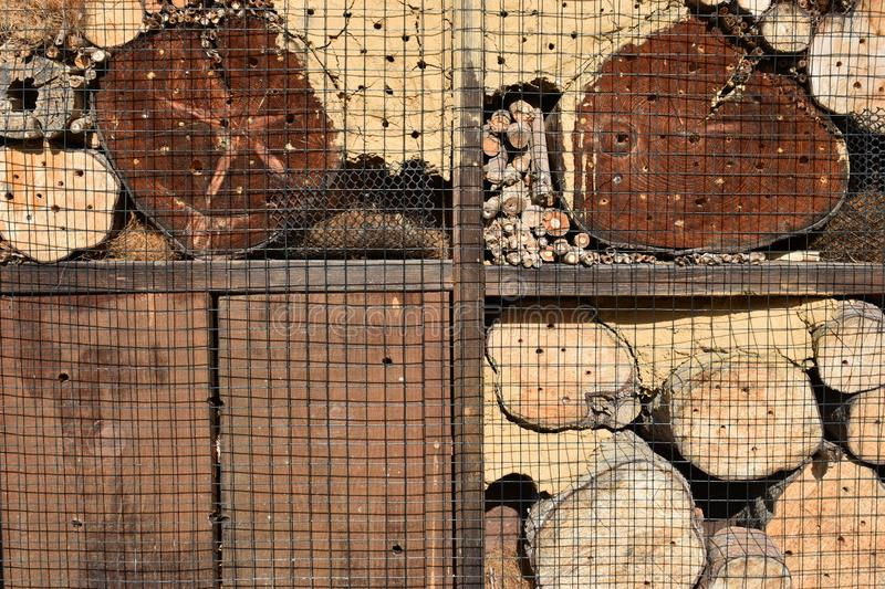 Wooden insect hotel for crawlers with stacked wood. Can be used as a background stock photo
