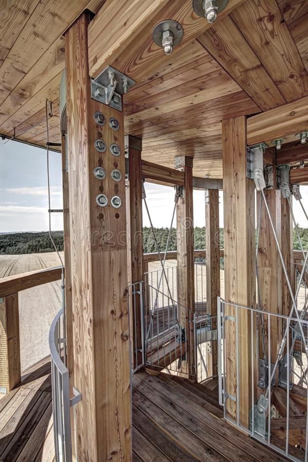 Wooden interior of the outlook tower. Wooden deck, ceiling, and poles on the top of outlook tower royalty free stock photo