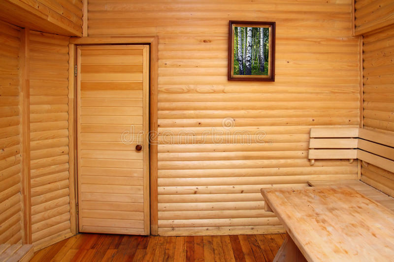Wooden interior of sauna rest room. Wooden interior with door of sauna rest room royalty free stock images