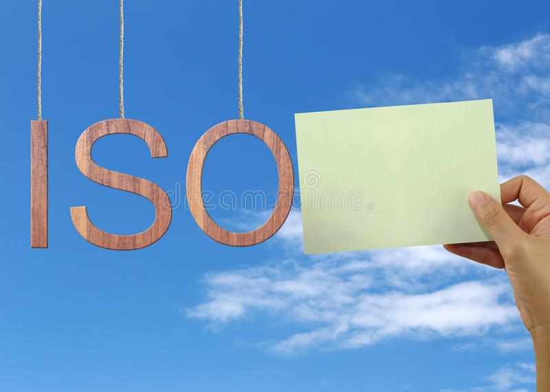 Wooden ISO text Stands for International Organization for Standardization hanging on rope. royalty free stock images