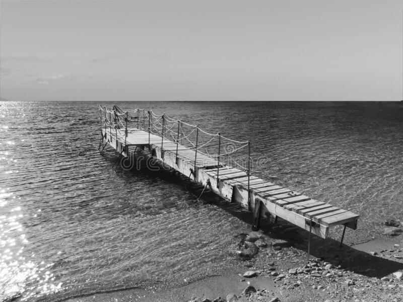 Wooden jetty at the beach stock photo