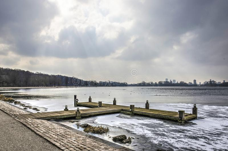Wooden jetty on a frozen lake royalty free stock photo