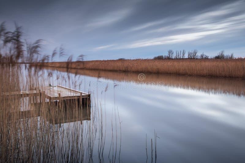 Wooden jetty by lake. Utvalinge, Sweden stock image