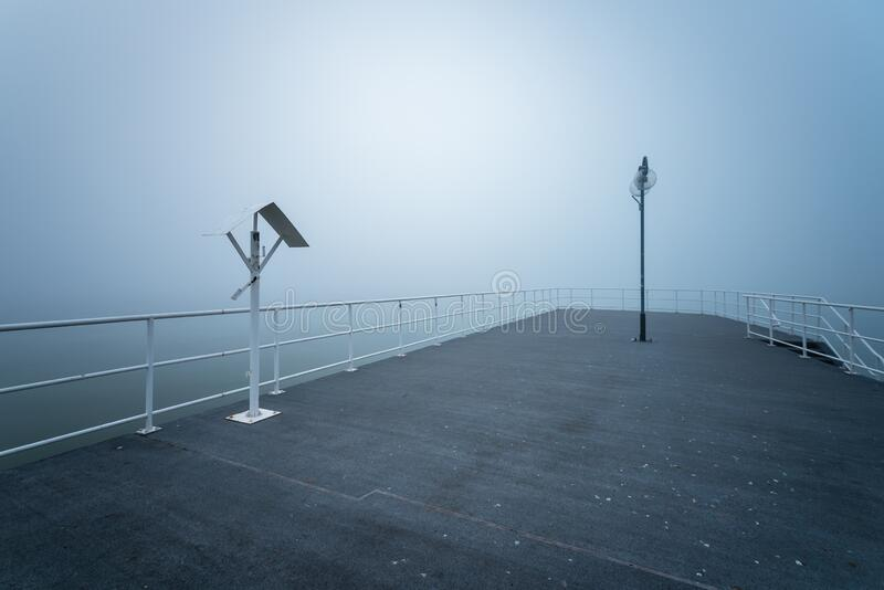 Wooden jetty by the sea. On a foggy morning. Baltic Sea Gdynia, Poland royalty free stock image
