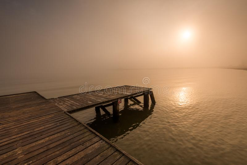 Wooden jetty by the sea. During the morning fog. Baltic Sea, Sopot Poland royalty free stock image