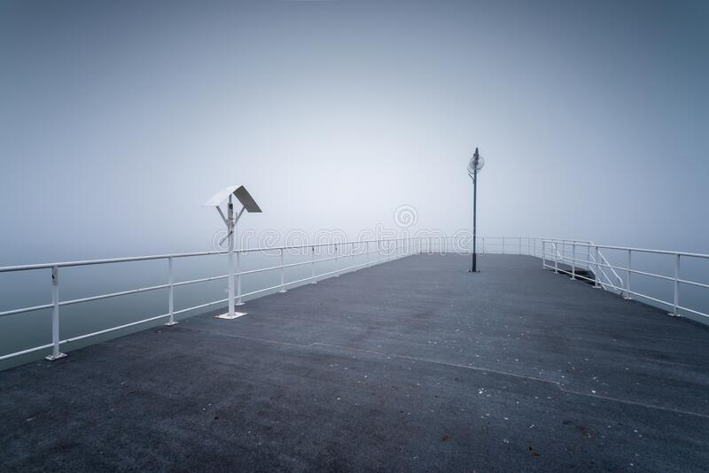 Wooden jetty by the sea. On a foggy morning. Baltic Sea Gdynia, Poland stock photos