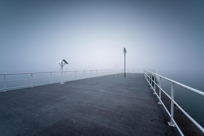 Wooden jetty by the sea. On a foggy morning. Baltic Sea Gdynia, Poland stock images