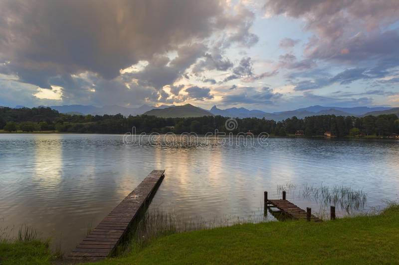 Wooden jetty in the water. Drakensberg South Africa stock images