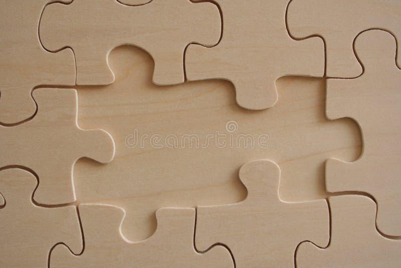 Wooden jigsaw royalty free stock photo