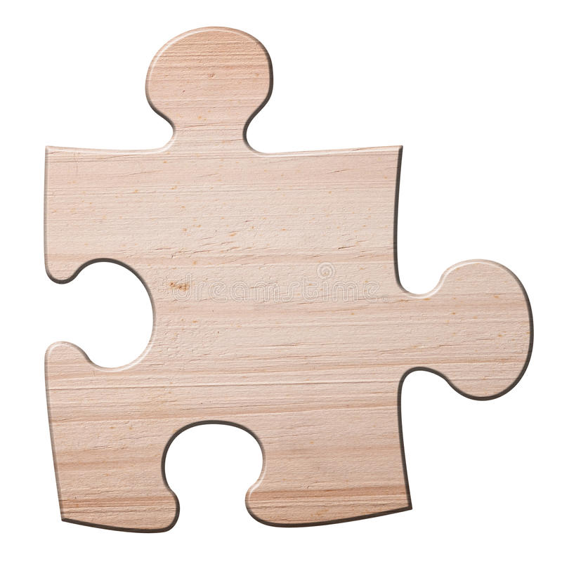 Wooden jigzaw puzzle piece. royalty free stock images