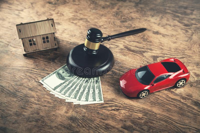 Wooden Judge Gavel, Money, House and Car. Auction and bidding co royalty free stock photography