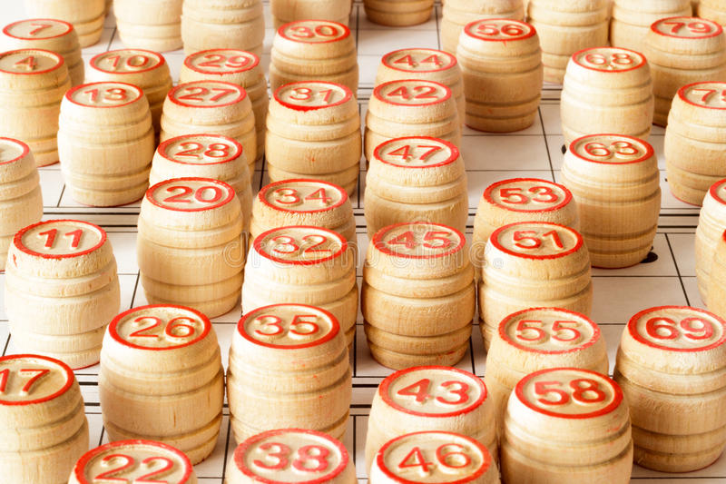 Wooden kegs and cards for lotto or bingo game. On white background stock image