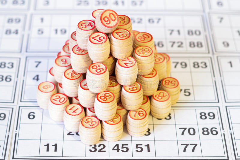 Wooden kegs and cards for lotto or bingo game. On white background stock photo
