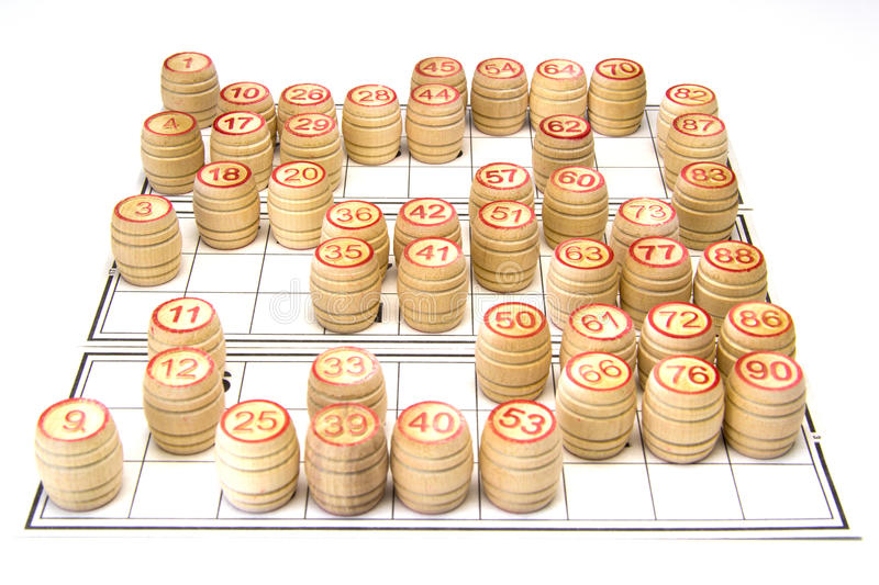 Wooden kegs and cards for lotto or bingo game. On white background stock images