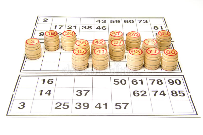Wooden kegs and cards for lotto or bingo game. On white background stock photos
