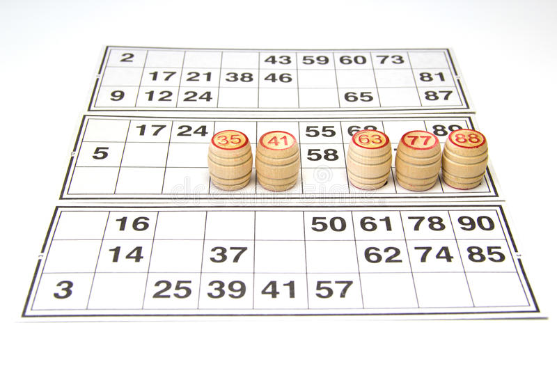 Wooden kegs and cards for lotto or bingo game. On white background stock photography