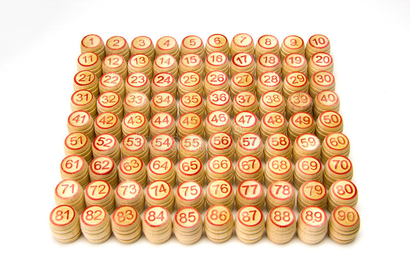 Wooden kegs and cards for lotto or bingo game. On white background royalty free stock photo