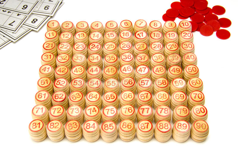 Wooden kegs and cards for lotto or bingo game. On white background royalty free stock images