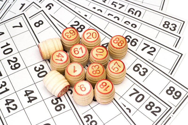 Wooden kegs and cards for lotto or bingo game. On white background royalty free stock photos