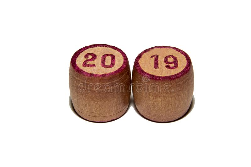 Wooden kegs for a game in a lotto with red numbers. 2019 year. Wooden kegs for a game in a lotto with red numbers. Gambling. Vintage barrels Bingo Board game royalty free stock image
