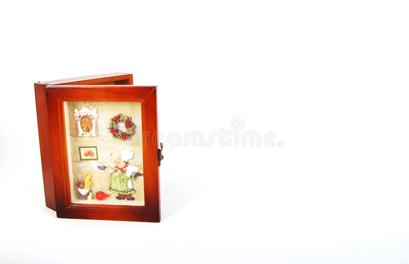 Wooden key holder with frame stock images