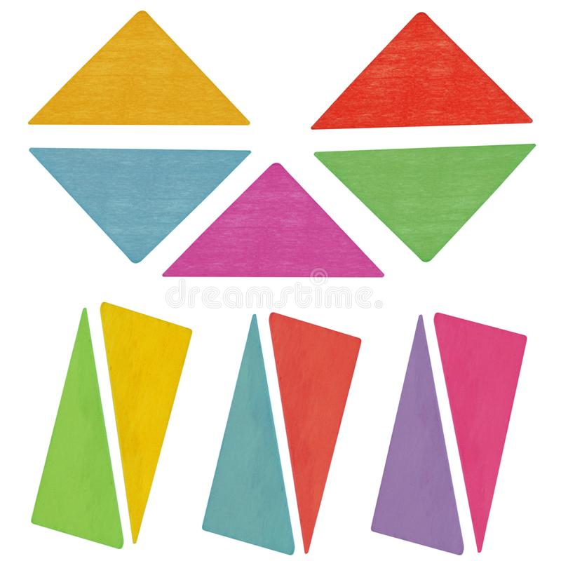 Wooden kids toy geometric shapes triangles. Isolated on the white background. Top view stock photography