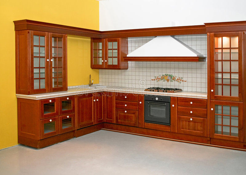Wooden kitchen. Big and new traditional look wooden kitchen royalty free stock photography