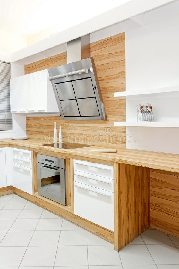 Wooden kitchen. Complete wooden kitchen vertical in new apartment stock image