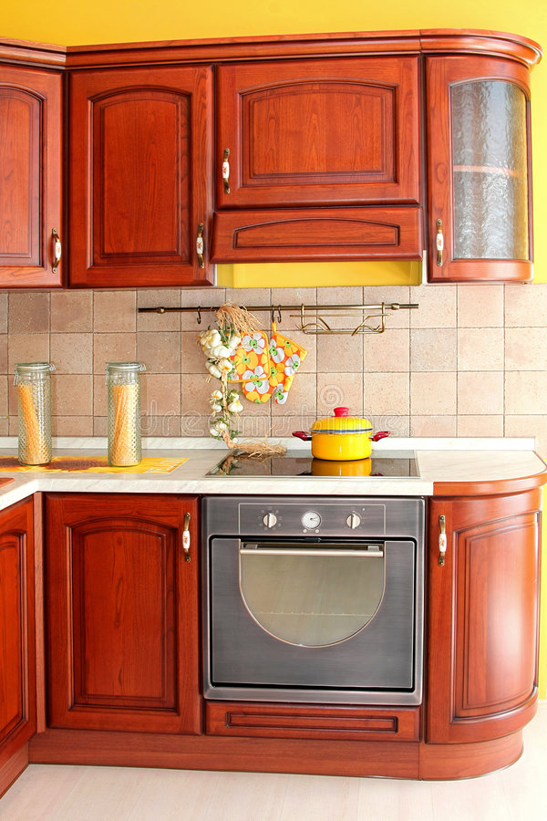 Wooden kitchen detail. Interior of wooden kitchen in classic style stock images