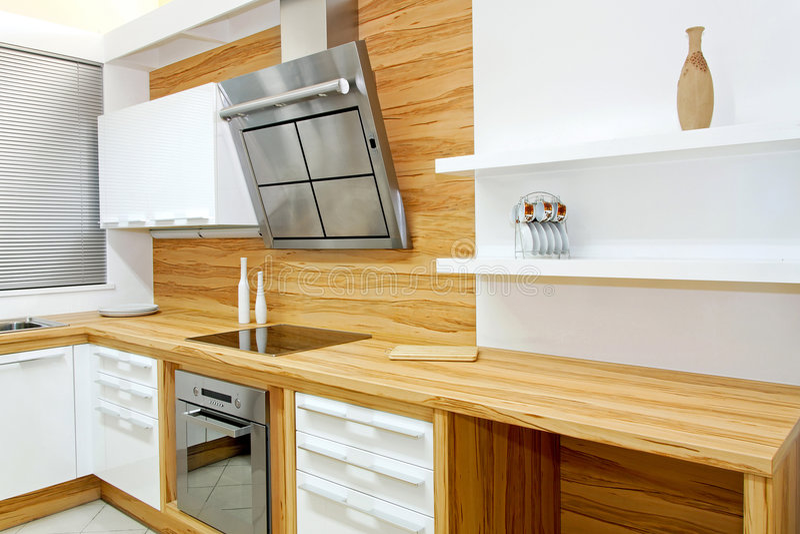 Wooden kitchen horizontal. Complete wooden kitchen horizontal in new apartment royalty free stock photo