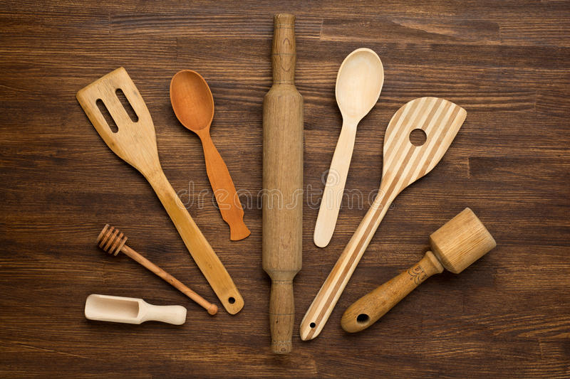 Wooden kitchen tools on vintage wooden background royalty free stock images