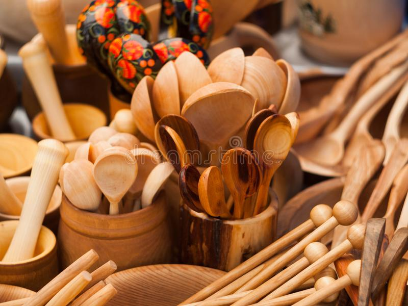 Wooden kitchen utensils. Ð¡ups and spoons. royalty free stock images