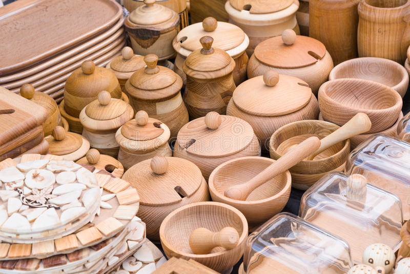 Wooden kitchen utensils. Various kitchen utensils made from wood for sale at craft market royalty free stock photo