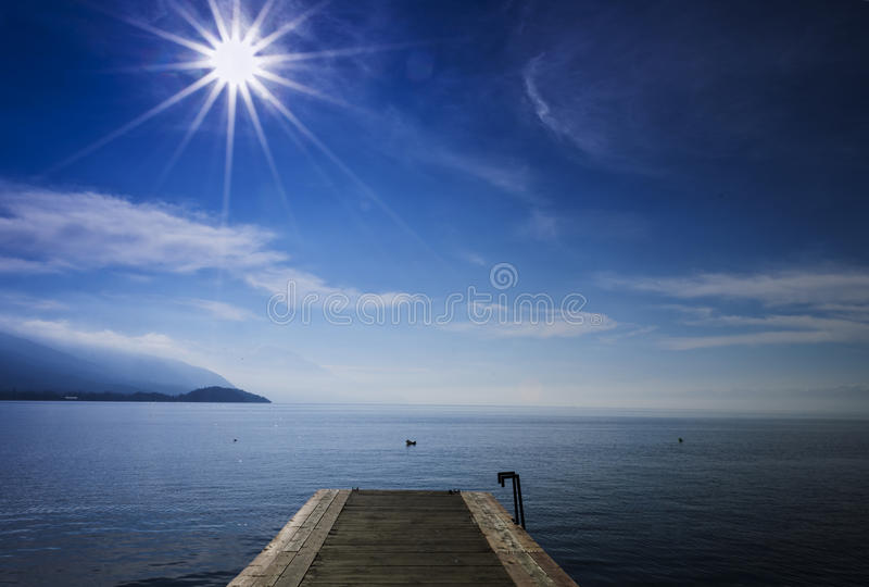 Wooden lake pier royalty free stock photo