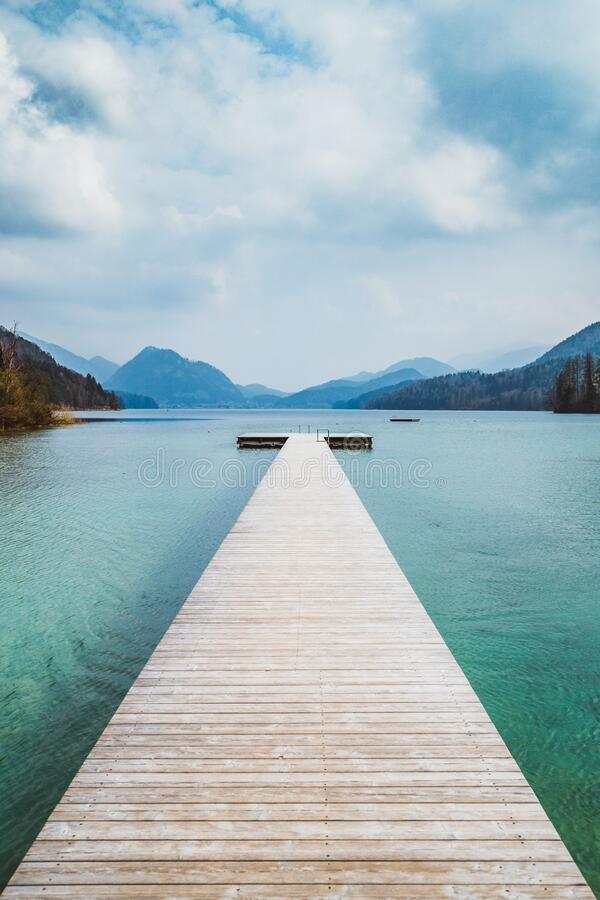 Free Wooden Landing Stage With Alpine Lake In Summer Royalty Free Stock Photography - 187248257