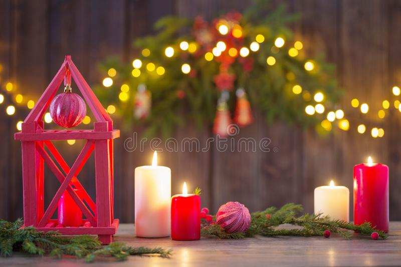 Wooden lantern with candles and Christmas branches stock photo