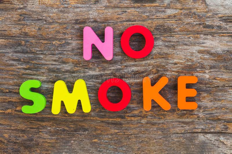 The wooden letter came in the word No Smoke royalty free stock photo