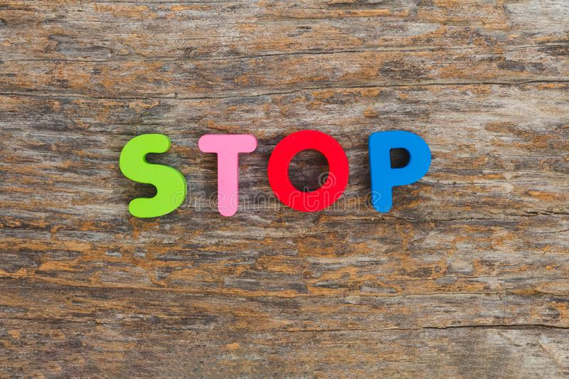 The wooden letter came in the word Stop stock images