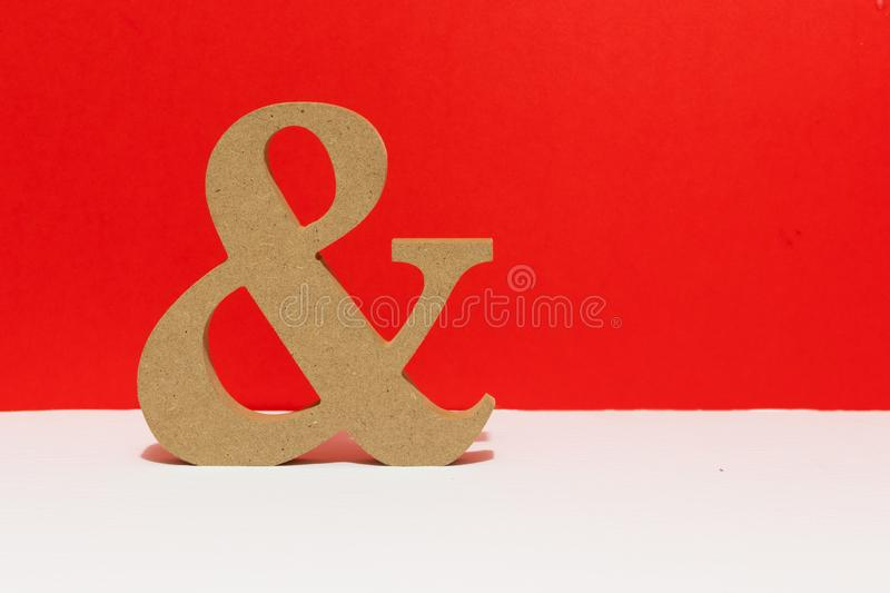 Wooden letter, and sign. red background. Metaphorical for couples love. Wooden letter, and sign, red background. Metaphorical for couples love and being together royalty free stock photo
