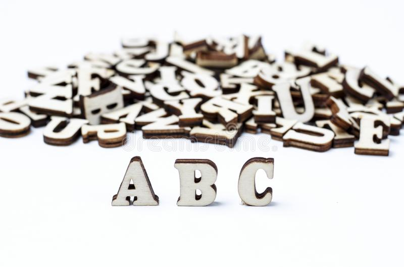 Wooden letters of the English alphabet close-up, background, education concept royalty free stock images