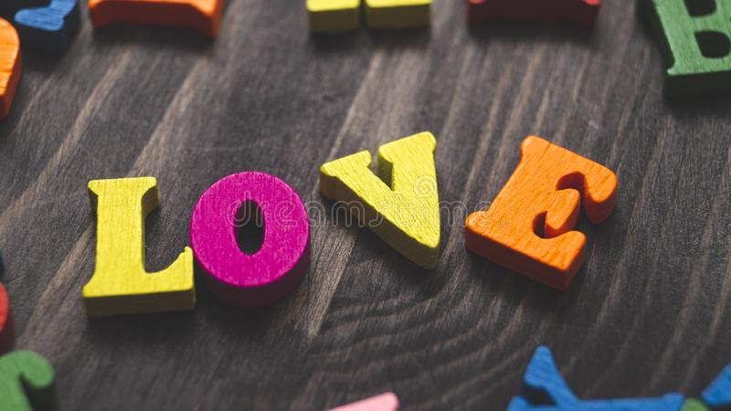 Wooden letters forming word LOVE. Written on wooden background stock images