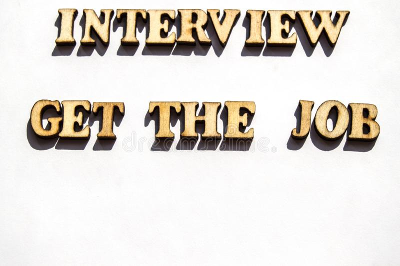 Wooden letters with a sharp shadow on a white background written word interview get the job search, the concept of interview for. Employment , recruitment royalty free stock images